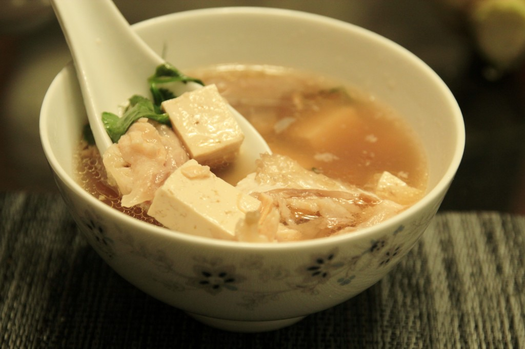 Salmon fish head and tofu herbal soup szechuan beef with for Fish head soup recipe